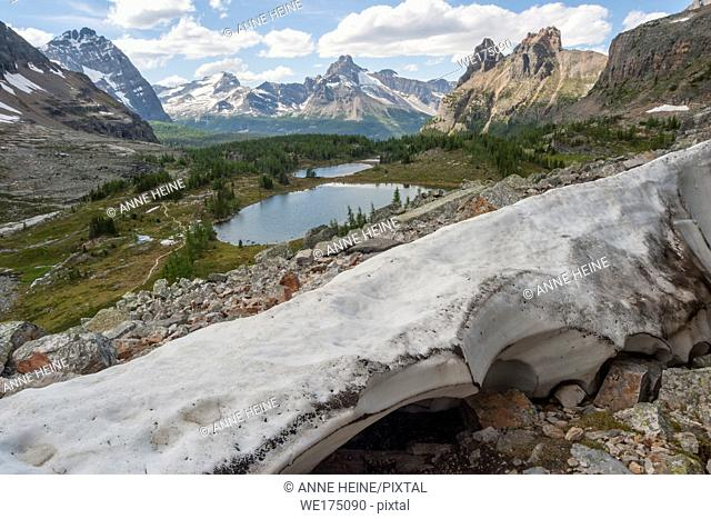 Remaining ice sheet in spring from glacier on Glaciar Peak. Lake O`Hara area with Lake Oesa in the background. British Columbia (border to Alberta)