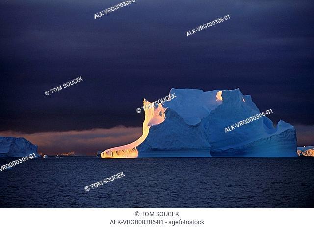 Large iceberg illuminated by evening sunlight Weddell Sea South Atlantic Ocean Antarctica Summer