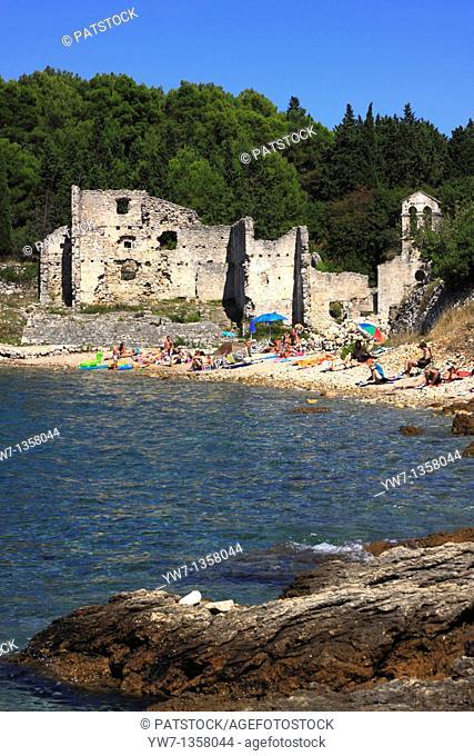 People on a beach at Bijar Bay in Osor, Croatia