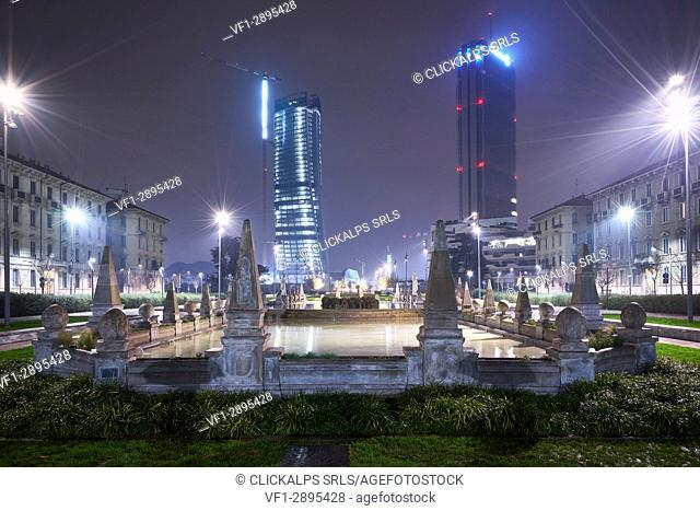 Milan, Lombardy, Italy. Citylife neighborhood with Fontana delle Quattro Stagioni by night