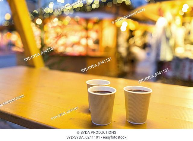 mulled wine in paper cups at christmas market