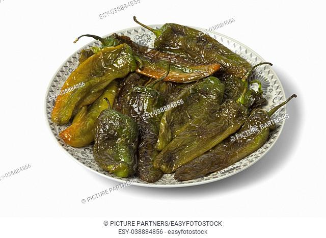 Moroccan dish with deepfried peppers isolated on white background