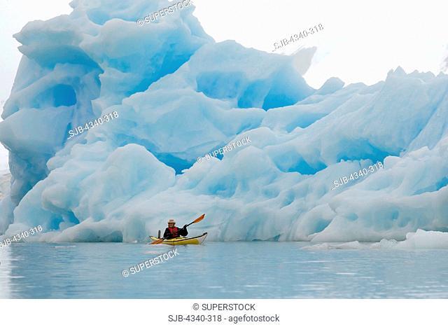 Sea Kayaker and Iceberg
