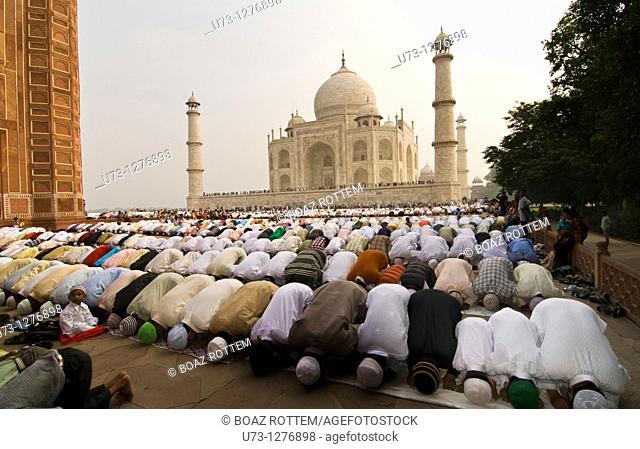 Muslim crowed praying by the Taj Mahal in Agra, India