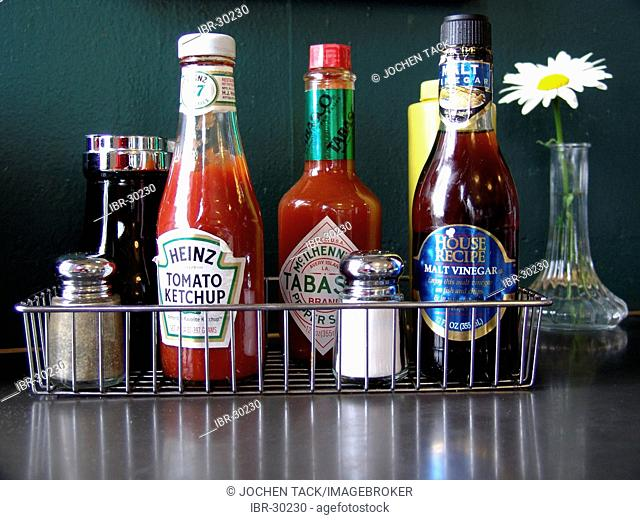 USA, United States of America : Ketchup, pepper, salt, etc on the table of a diner restaurant