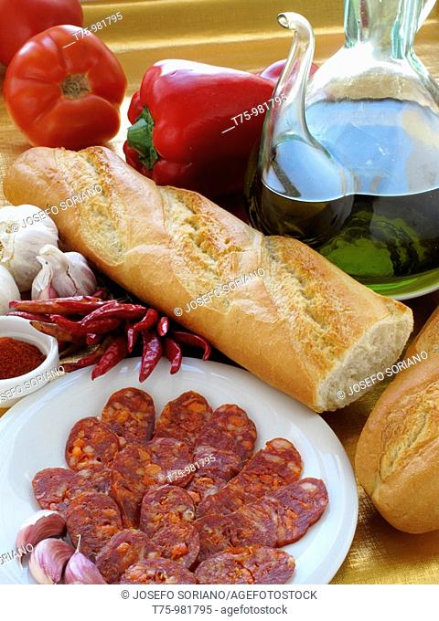 Chorizo, tomato, garlic, paprika, bread, paprika and oil
