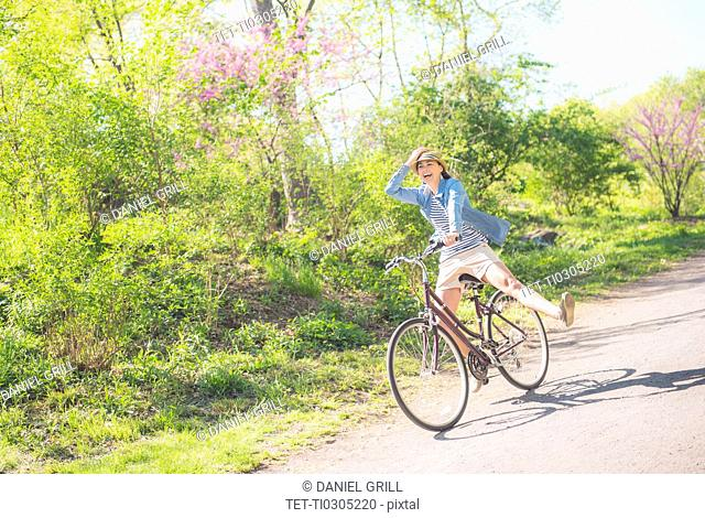 Mid adult woman riding bicycle