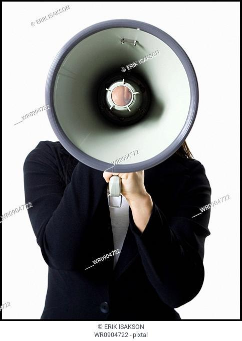 Close-up of a teenage girl holding a megaphone