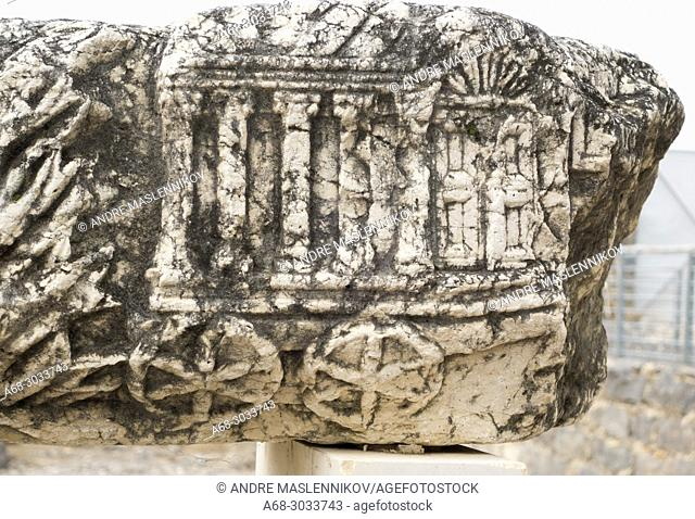 Stone carving showing the wheeled vehicle that carried the covenant of the ark Capernaum, Israel. Capernaum. Parts of the synagogue stones are displayed in the...