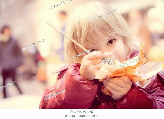 Boy eating candy apple