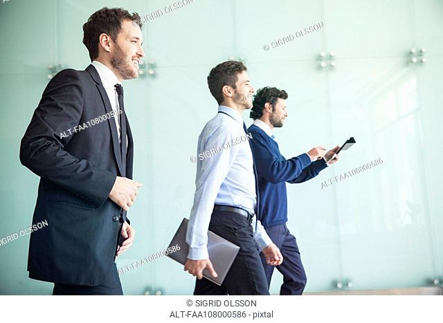 Businessmen walking together with confidence