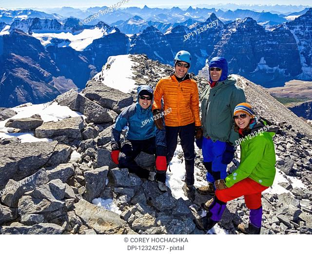 A family posing while hiking in the Rocky Mountains; Banff, Alberta, Canada
