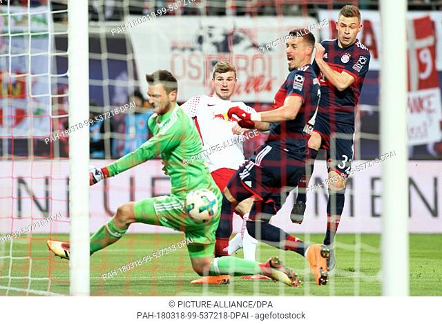 18 March 2018, Germany, Leipzig: Soccer, Bundesliga, 1. RB Leipzig vs Bayern Munich at the Red Bull Arena. Leipzig's Timo Werner attempting to overcome Munich's...