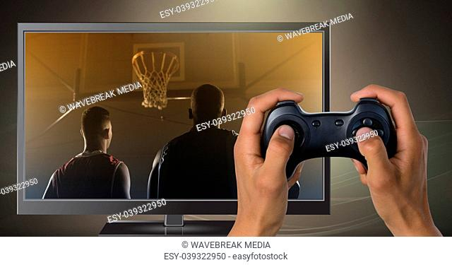 Hands holding gaming controller with basketball players on television