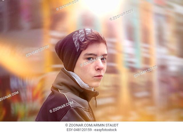portrait of a beautiful teenage boy with winter clothes