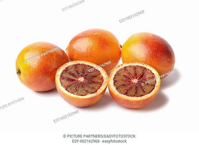 Blood oranges on white background