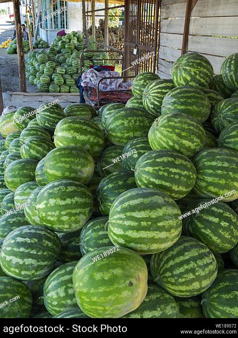 Selling of melons at roadside. City Jalal-Abad (Dzhalal-Abad, Djalal-Abat, Jalalabat) in the Fergana Valley close to the border to Uzbekistan