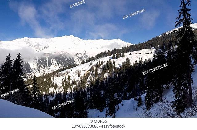 Foisch, Switzerland - February 7, 2015: Beautiful sunny day and the snow in the Italian Switzerland. Airolo, Hut Foisch