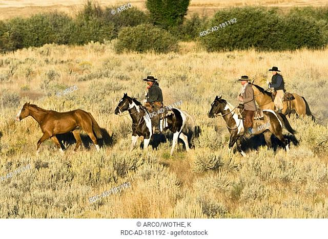 Cowboy and cowgirl in western outfit, riding on horses, Ponderosa Ranch, Oregon, USA, Wild West