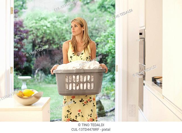 Young woman depressed at housework