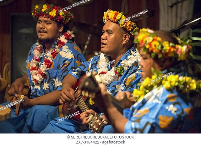 Entertainment group singing in the Paul Gauguin cruise ship. France, French Polynesia, Polynesian, South Pacific