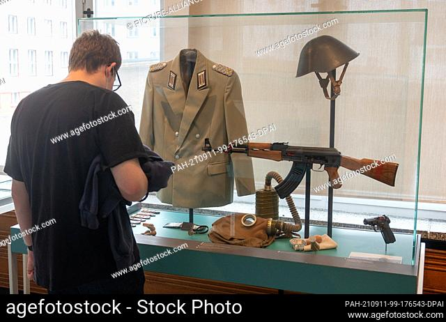 11 September 2021, Berlin: During the Open Monument Day at the former Stasi headquarters, a visitor looks at the equipment of an employee of the GDR's Ministry...