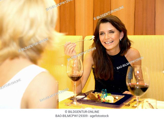 Two women eating in a restaurant