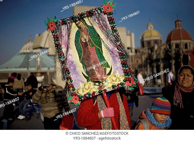 A pilgrim carries an image of the Our Lady of Guadalupe outside of the Our Lady of Guadalupe Basilica in Mexico City, December 9, 2012