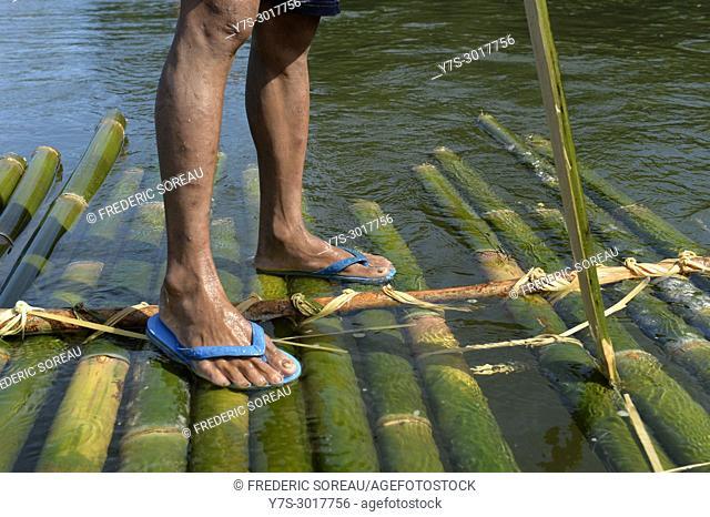 Bamboo raft in a river, close-up of feet, Ratanakiri Province, Cambodia, South East Asia, Asia