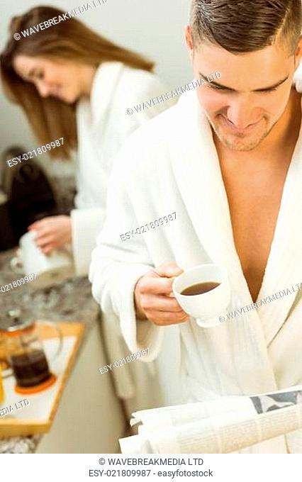 Cute couple in their bathrobes at breakfast