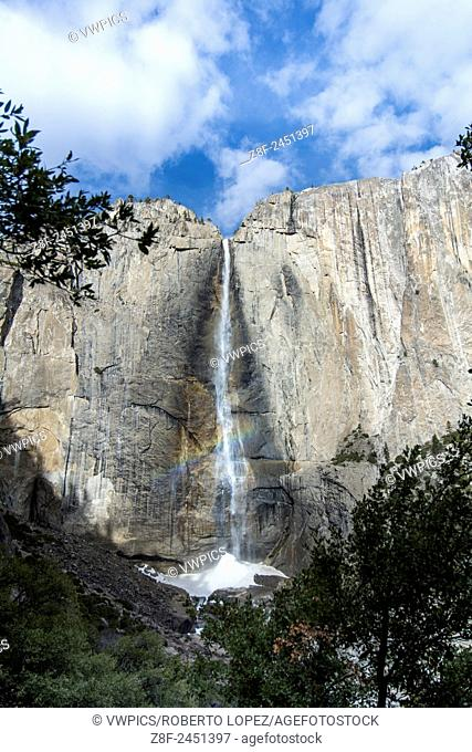 The front view of the Waterfall at Yosemite Falls, and the cold water building up below as snow because of the cold, Yosemite National Park, California, USA
