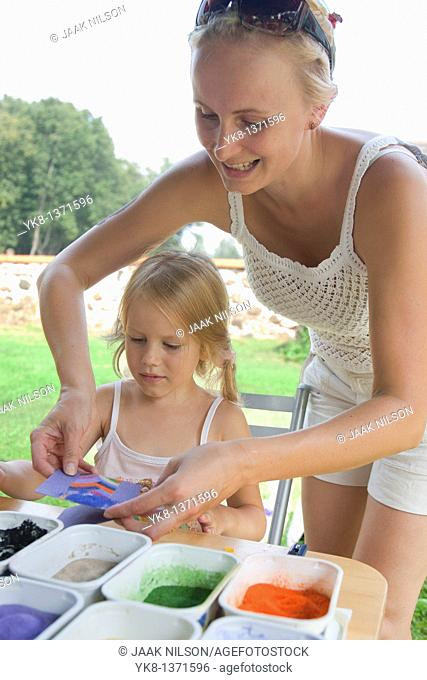 Four Year Old Young Kid Girl with Mother Working with Color Sand in Art Class