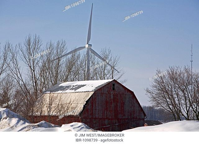 A wind turbine near a barn in the Noble Thumb Windpark, owned by John Deere Wind Energy, Ubly, Michigan, USA