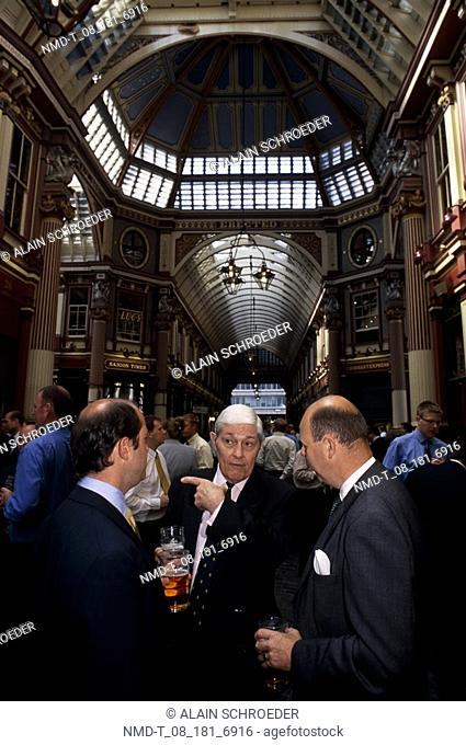 Group of businessmen in a party, Leadenhall Market, London, England