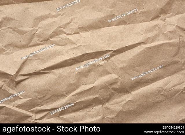 fragment of crumpled blank sheet of brown wrapping kraft paper, vintage texture for the designer, full frame