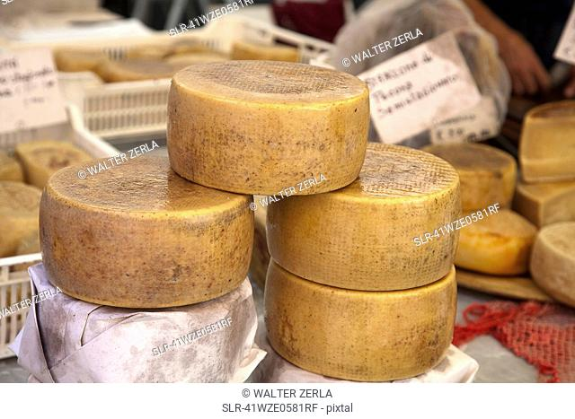 Close up of cheese wheels for sale