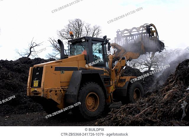 Front loader working at composting centre