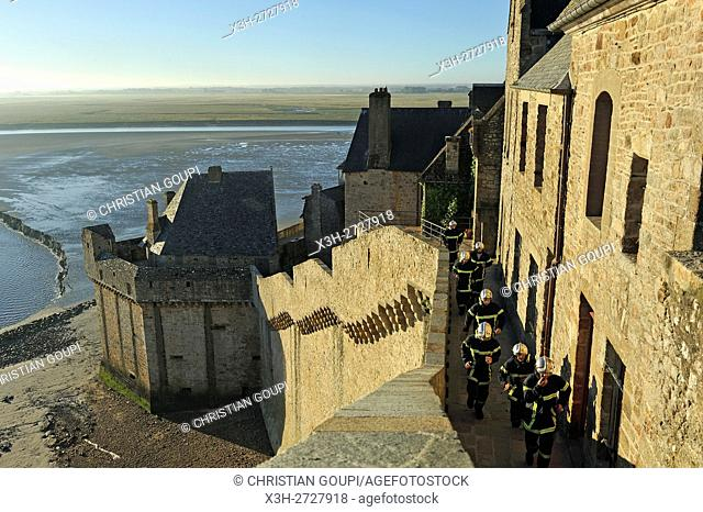 firemen in training on the ramparts of Mont-Saint-Michel, Manche department, Normandy region, France, Europe