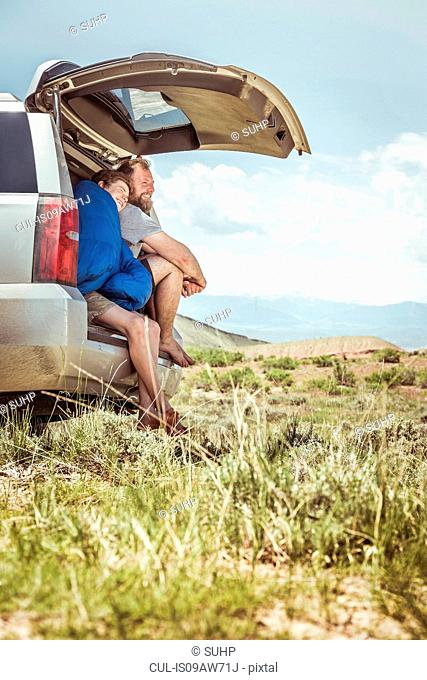 Mature man and teenage son looking out from off road vehicle, Bridger, Montana, USA