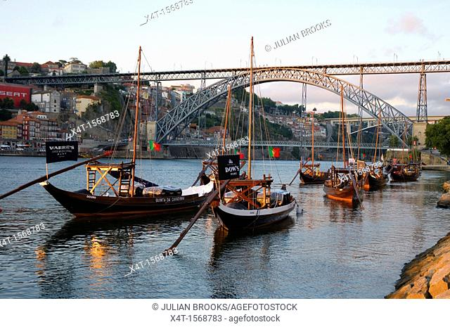 Porto, Port Wine Barges And The Ribeira District in late afternoon with the Dom Luis bridge in the background