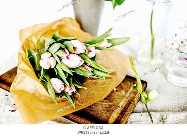 Tulip bouquet on chopping board