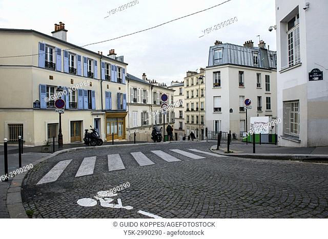 Paris, France. Neigbourhood intersection and square in Montmartre, with domestic houses and apartments
