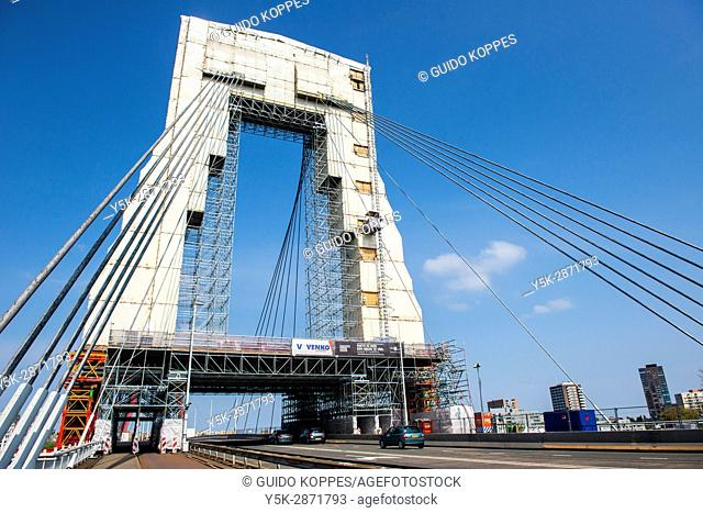 Rotterdam, Netherlands. The iconic Willemsbrug / Willems Bridge covered in protection during large, periodical maintenance and overhaul