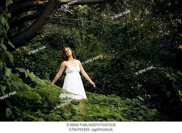Young Asian woman enjoying the forest alone