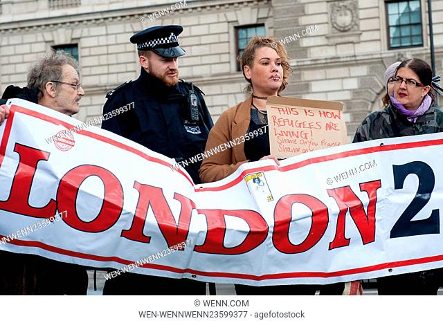Activists from Refugees Welcome, No Borders and London 2 Calais groups protest on Parliament Square and Westminster Bridge