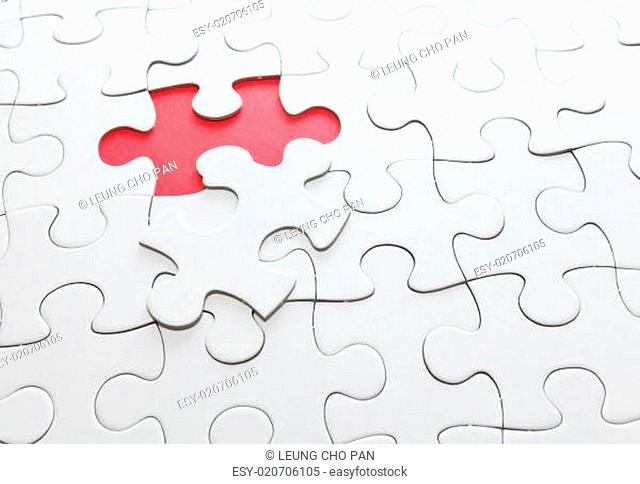 puzzle with missing red piece