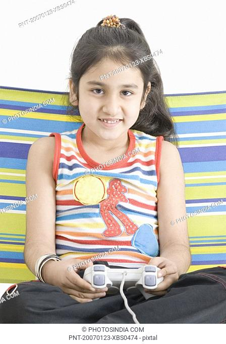 Portrait of a girl playing video game