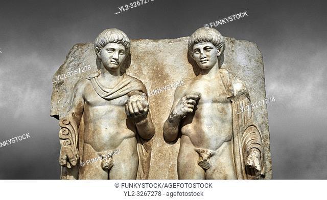 Close up of a Roman Sebasteion relief sculpture of Two princes, Aphrodisias Museum, Aphrodisias, Turkey. Against a grey background.