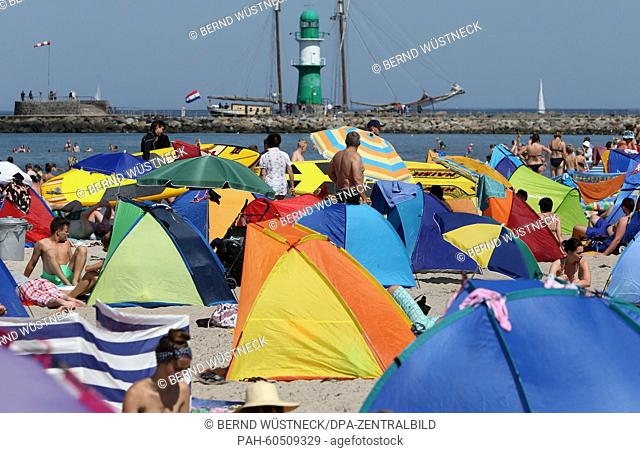 Vacationers flock to a Baltic Sea beach in Rostock-Warnemuende, Germany, 03 August 2015. As school summer break has started in several German states