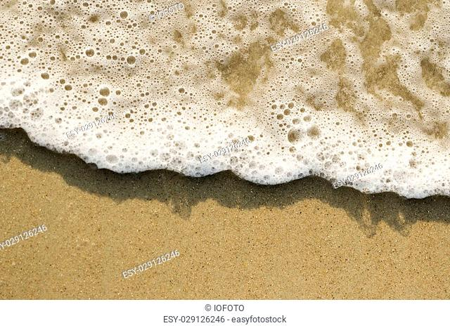 Close-up of sand and wave
